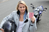 Young woman with motorcycle and French license — Stock Photo