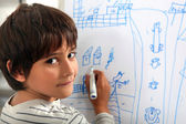 Child drawing a street scene — Stock Photo