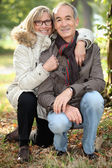 Middle-aged couple walking in the park — Stock Photo