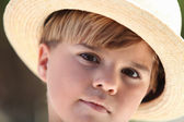 Little boy wearing a straw hat — Stock Photo