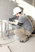 Plumber working on a site — Stock Photo