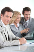 Businessman and colleagues — Stock Photo