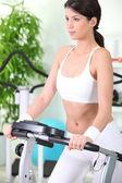 Woman on a treadmill — Stock Photo