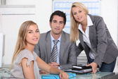 Three colleagues in office — Stock Photo