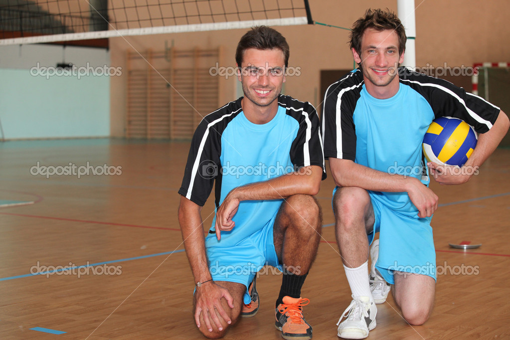 Volleyball players kneeling  Stock Photo #8060881