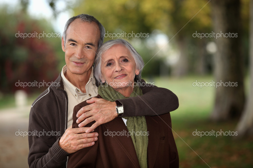 Old couple walking through park  Stock Photo #8064629