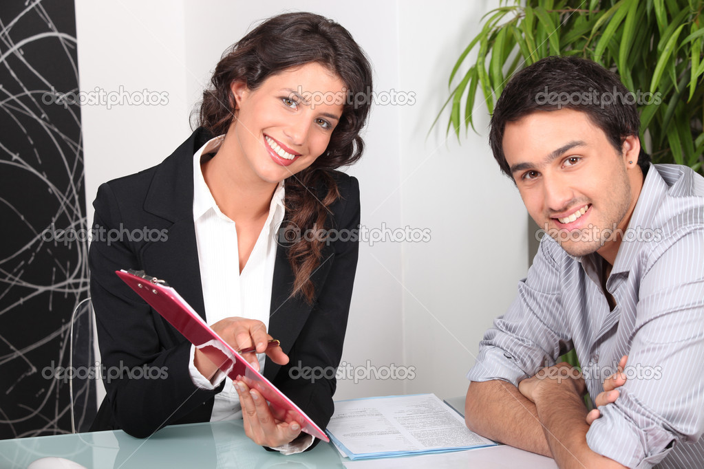 Woman showing man where to sign — Stock Photo #8065230