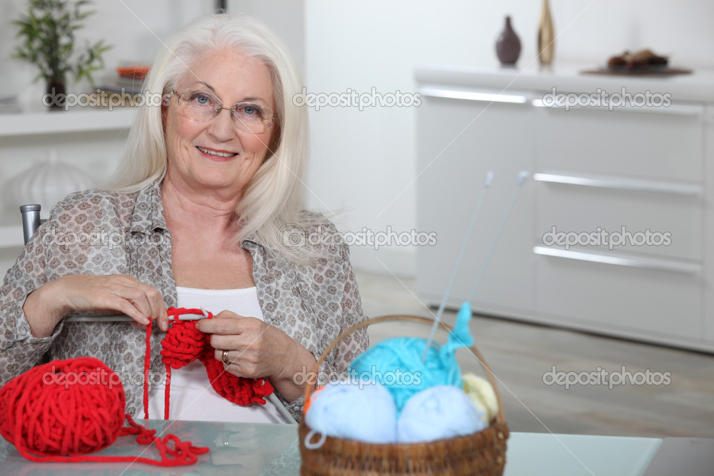Old Lady Knitting Images : Old lady knitting in kitchen stock photo � photography