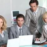 Serious team of executives — Stock Photo