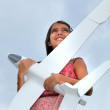 Girl with model plane — Stock Photo