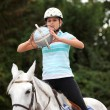 Young woman playing horse-ball — Stock Photo #8071652