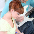 Stock Photo: Musicians composing song together