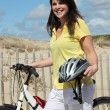 Young woman with bike at the beach — Stock Photo #8078399