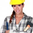 Stock Photo: Womwith hammer and chisel