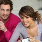 Couple having fun playing video games — Stock Photo
