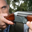 Man aiming a rifle — Stock Photo #8078607