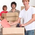 Three men moving house — Stock Photo
