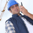 Foreman in front of a crane, low-angle shot — Stock Photo #8078740