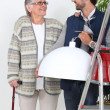 Young man helping older woman — Stock Photo #8078943