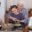 Stock Photo: Family cooking pancakes