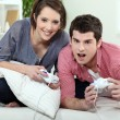 Young couple playing video game together — Stock Photo #8079227