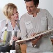 Couple following a recipe — Stock Photo #8079976