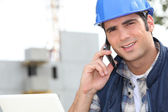 Construction worker using a mobile phone — Stock Photo