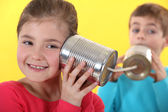 Kids using tin cans to communicate — Stock Photo
