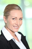 Profile view of blond businesswoman — Stock Photo