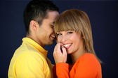 Young couple giggling together — Stock Photo
