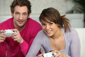 Couple having fun playing video games — Stock Photo