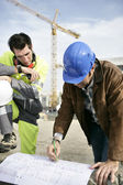 Foreman with site plans — Stock Photo