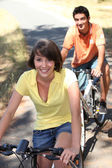 Teenagers out cycling together — Stock Photo