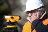 Civil engineer with surveying equipment — Stock Photo