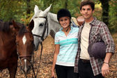 Horseback riders with their horses — Stock Photo