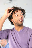 Man with stubble putting his glasses on his head — Stock Photo