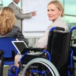 Bussinesswoman in wheelchair — Stock Photo