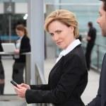 Businesswoman texting — Stock Photo #8080584