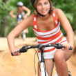 Teenage girl cycling — Stock Photo