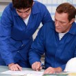 Blue collars in office: apprentice and instructor — Stock Photo #8080643