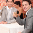 Men having a celebratory drink — Stock Photo