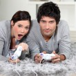 Couple playing a video game together - Stok fotoğraf