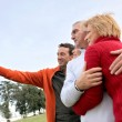 Family taking their own picture with a phone — Stock Photo