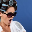 Young woman wearing sunglasses with her hair in rollers — Stock Photo #8080988
