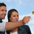 Couple tasting wine outdoors — Stock Photo