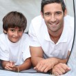 Father and son camping in a tent — Stock Photo