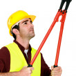 Stock Photo: Manual worker with bolt cutter