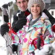 Portrait of a couple on a skiing holiday - Stock Photo