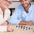 Mother and son playing draughts — Stock Photo #8081125