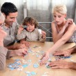 Stock Photo: A family making a puzzle